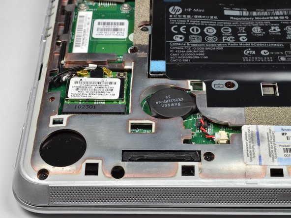 The RTC battery is a thin disk near the bottom left corner.