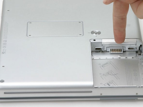 Flip down the door on the right side of the battery compartment.