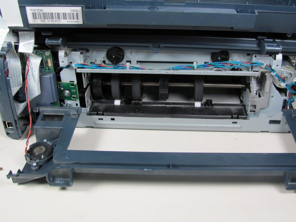 Returning to the back of the printer, remove the scanner from the back hinges.