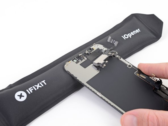 Use a hair dryer or heat gun or prepare an iOpener and apply it to the top front of the display for 1-2 minutes, in order to soften the adhesive securing the sensors.