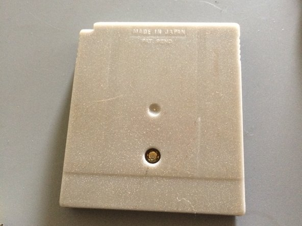 On the back side of the cartridge is a security bit, that you will need to take out first