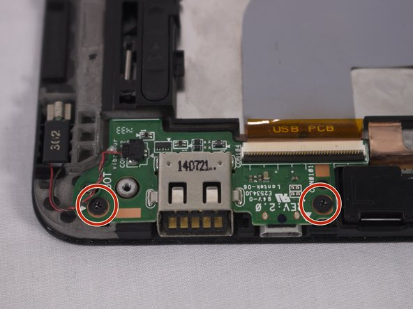 Using a Philips #000 screwdriver remove the two 2.5 mm screws indicated.