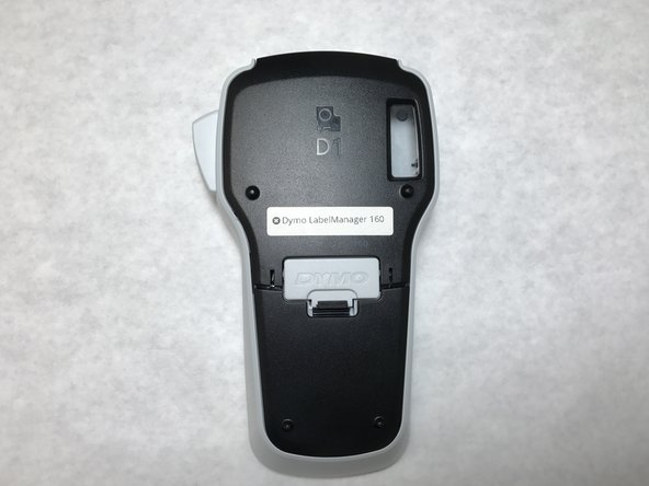 Place the device face-down to access the battery compartment.