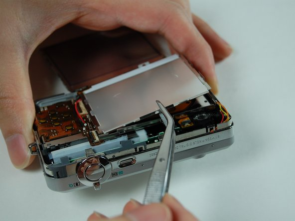 Use your tweezers to lift the LCD frame from the camera.