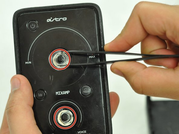Using tweezers, remove the spacer nuts and washers from each dial post.
