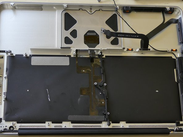 Now that you have removed the display (only required if a new top case is used to replace the keyboard), logic board, optical drive, and various other components from the upper case (or top case) You should have something that looks like this!