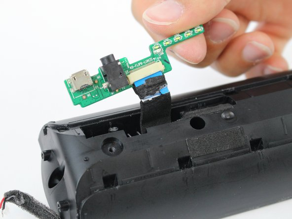 Gently pull the I/O board out from the speaker.