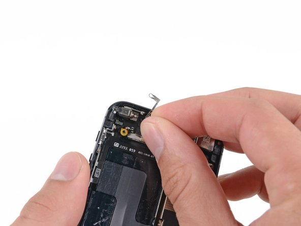 Remove the vibrator bracket from the rear case.