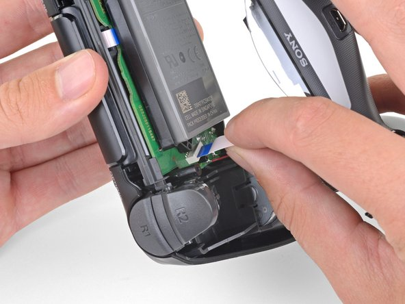 Use your fingers to gently pull the ribbon cable straight out of its connector on the motherboard.