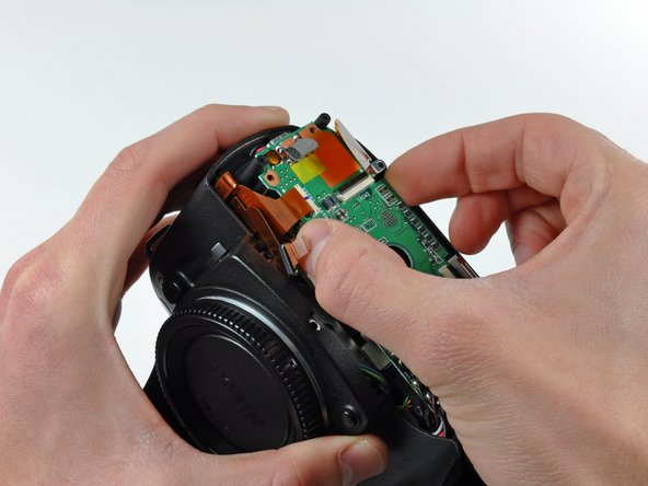 Grab the memory compression board by its edges at the position shown in the first picture.