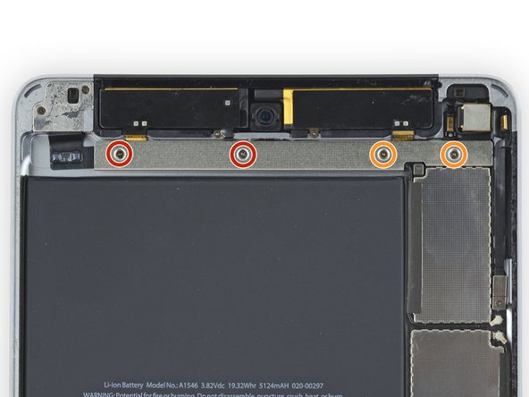 Remove the following four Phillips screws holding the upper component bracket in place: