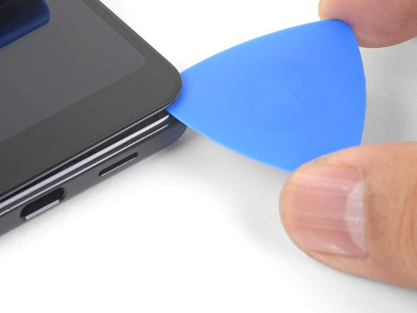 """As you slice around the bottom edge of the phone, do not insert the pick more than 1/4"""" (6 mm)."""