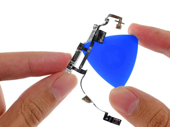 Use the point of the opening pick to peel the mechanical volume buttons up from the bracket.