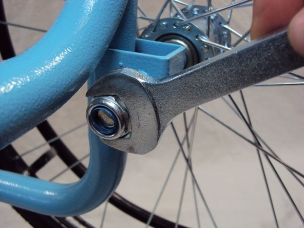 Unscrew the axle nut with a 19 mm wrench.