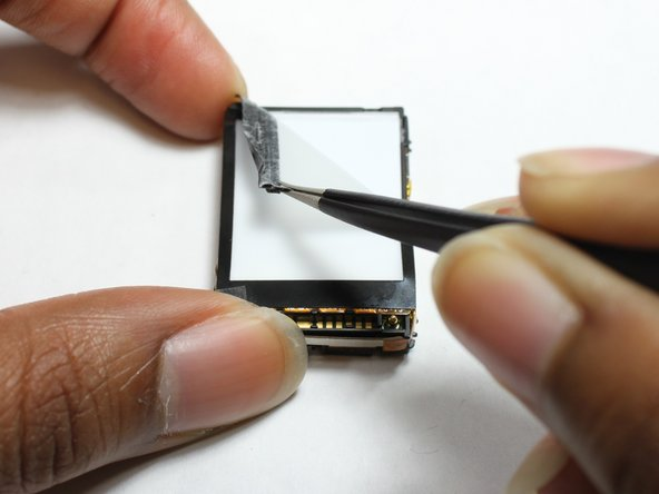 Starting in the top right corner, use a pair of tweezers to remove the white film.