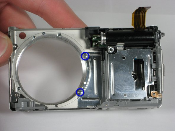 After removing the AV circuit board you are left with the front casing attached to the inner casing and flash unit.