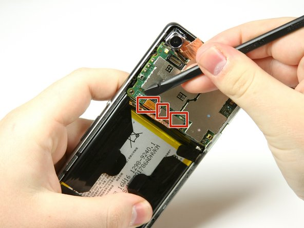 Use the spudger to detach the three copper connectors on the bottom area of the motherboard.