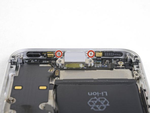 Remove the two 1.4 mm Phillips screws securing the Lightning port to the bottom edge of the phone.