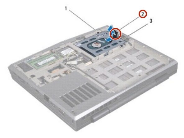 Using the pull-tab, pull the hard-drive assembly to disconnect the hard-drive assembly from the connector on the system board.