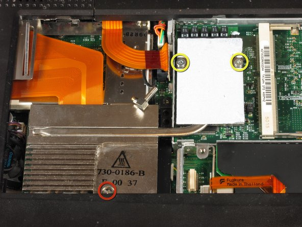 Remove the two T8 Torx screws that attach the heat sink to the processor.