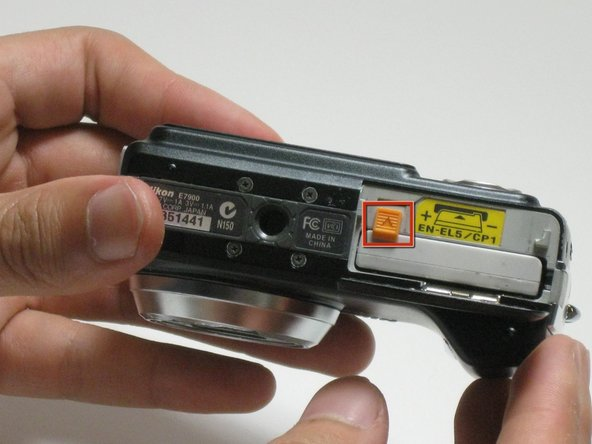 Push orange latch forward to release battery.