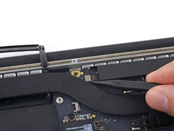 Use the point of a spudger to pry the keyboard backlight connector up from its socket on the logic board.