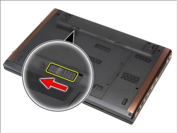 Slide the other battery release latch to the unlock position.