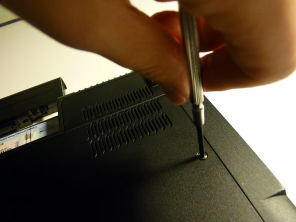 Unscrew the screws holding the panel on the underside of the laptop