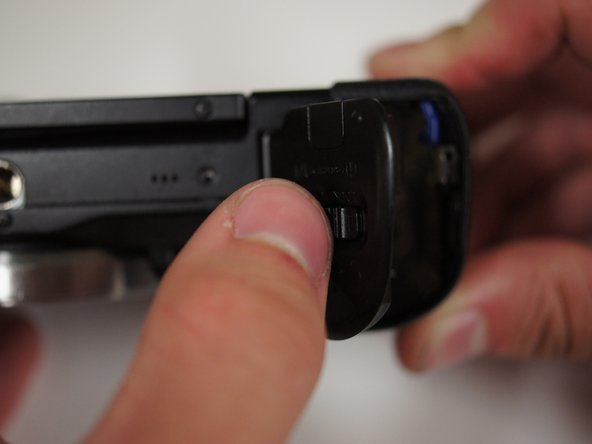 Close the battery door by pushing it down until it latches shut.