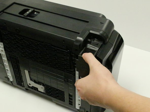 The AC adapter will now be loose, and able to come away from the printer.