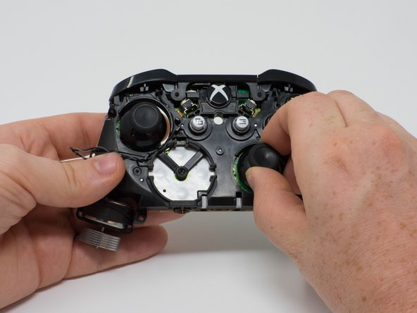 Pull the joysticks off of the controller.
