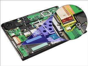 Extracción de la unidad de disco duro y placa de audio Dell Vostro V130