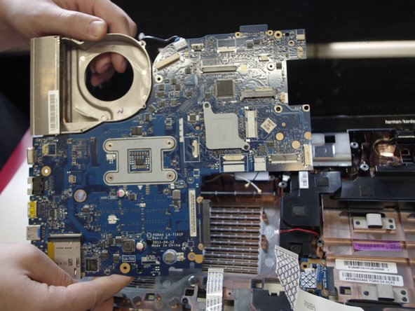 Remove the motherboard.
