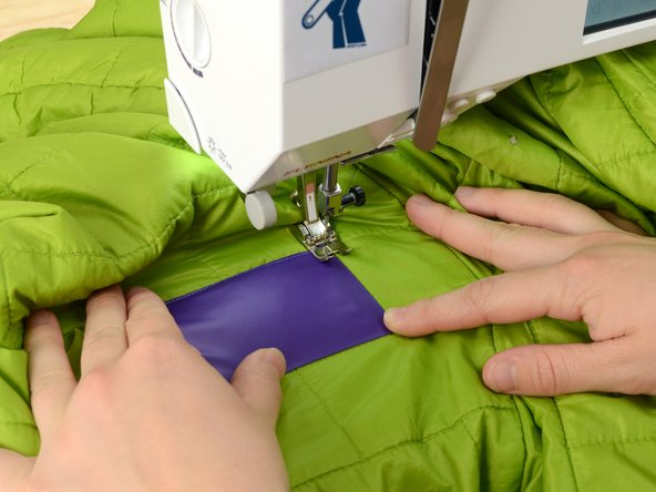 As you did with the first corner, sink the needle, lift the presser foot, and rotate the garment.