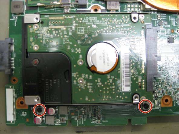 Finally you can find the hard disk drive on the back side of the motherboard.