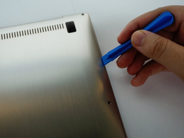 Carefully slide your iFixit Opening Tool between the back panel.