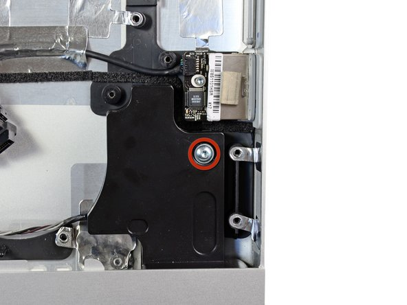 Remove the single 13 mm T10 Torx screw securing the right speaker to the outer case.