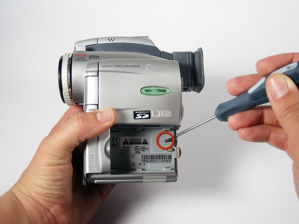 Remove the #00 Philips 4mm screw shown.