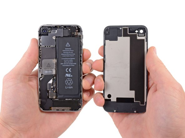 Pull the rear panel away from the back of the iPhone, being careful not to damage the plastic clips attached to the rear panel.