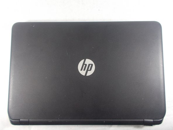 Close the laptop and flip it over so that the HP cover logo is on the underside of the laptop.