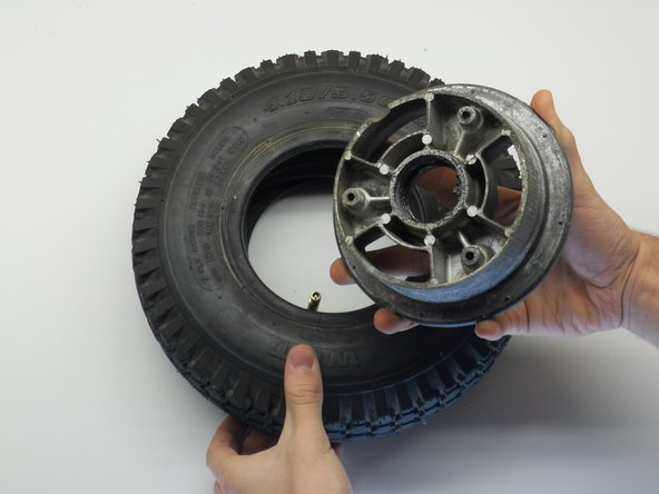 Gently pull out the valve stem so that it faces you. You may have to flip the tire to make it face you.