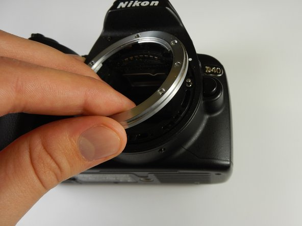 Once all 6 screws are removed, the lens mount can be gently removed from the camera.