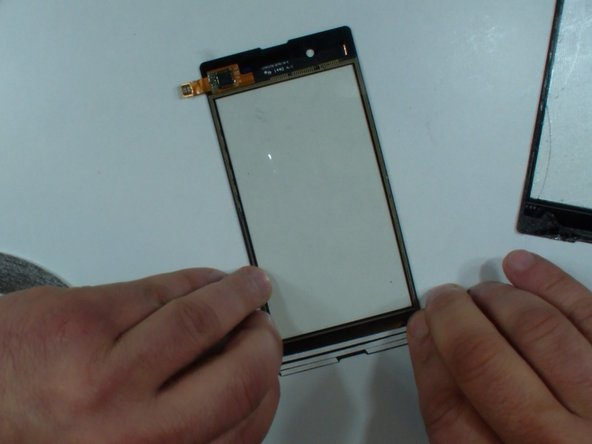 On the new touch screen or on the main frame put adhesive sticker 3mm.