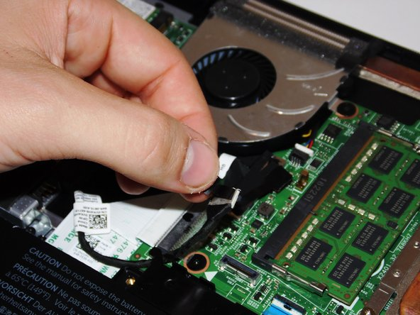 Unplug and gently pull the hard drive cable to loosen it.