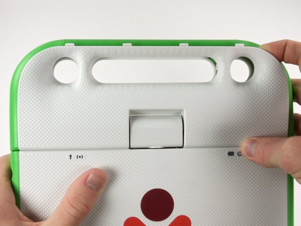 Turn the laptop so that the red XO symbol is right side up.