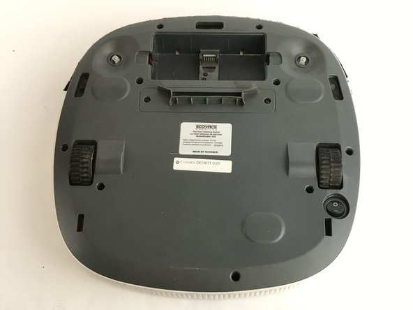 Lay the Deebot face down so you have access to the battery compartment. Remove the battery.
