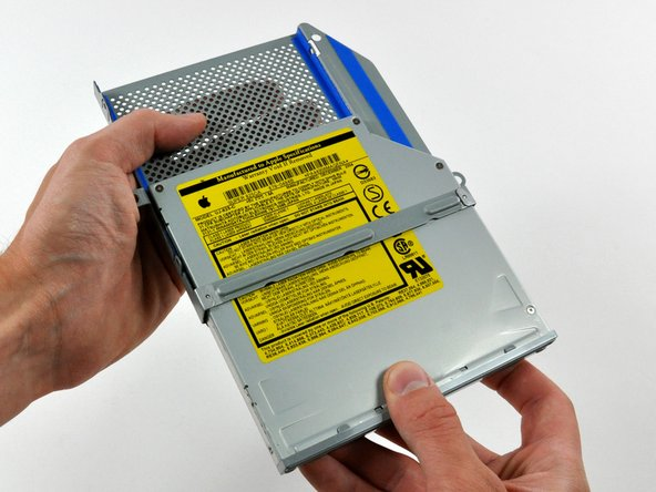 Pull the optical drive away from the cage by its open side.