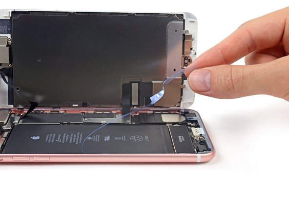 Continue removing the release liner from the entire perimeter of the iPhone.