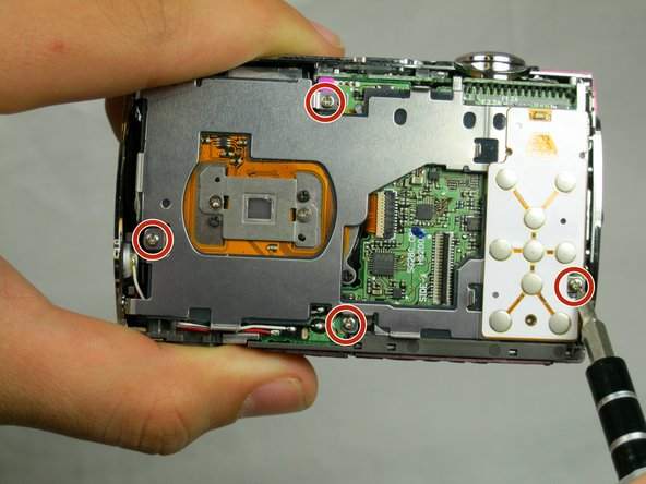 Remove the four 3.8 mm screws located near the bottom right and top left of the LCD base plate.