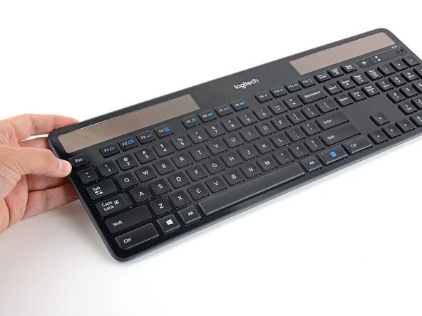 Flip the entire keyboard over, keys facing down.